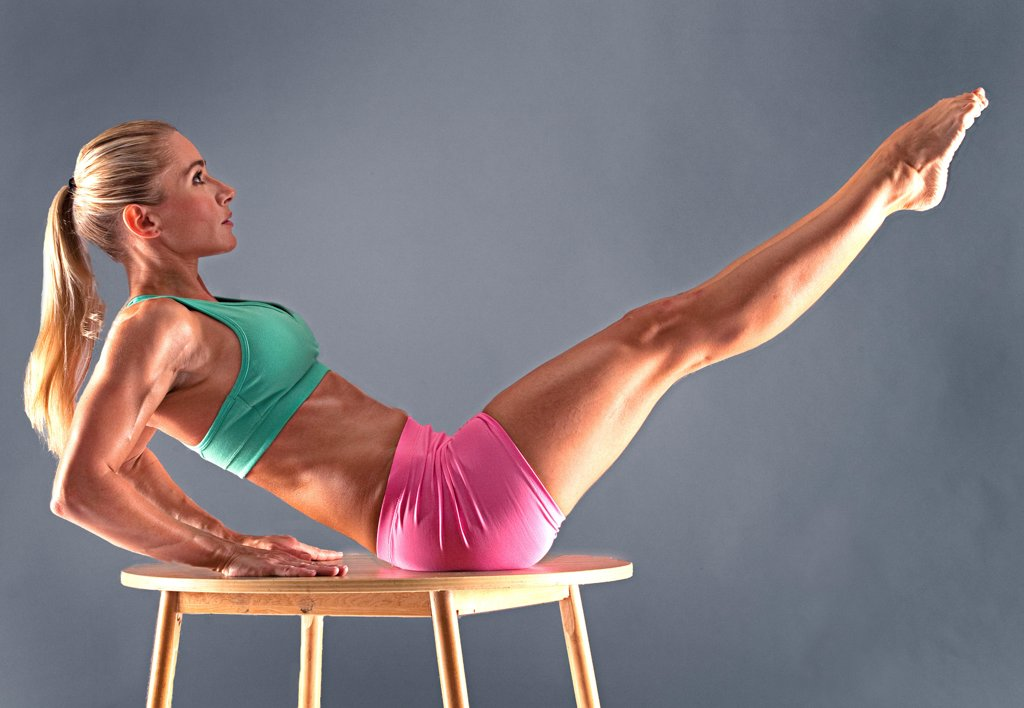 Stock Photo: 1087-3974 Studio shot of exercising woman