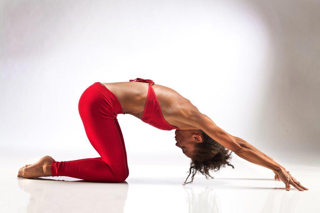 Stock Photo: 1087-3982 Studio shot of exercising woman