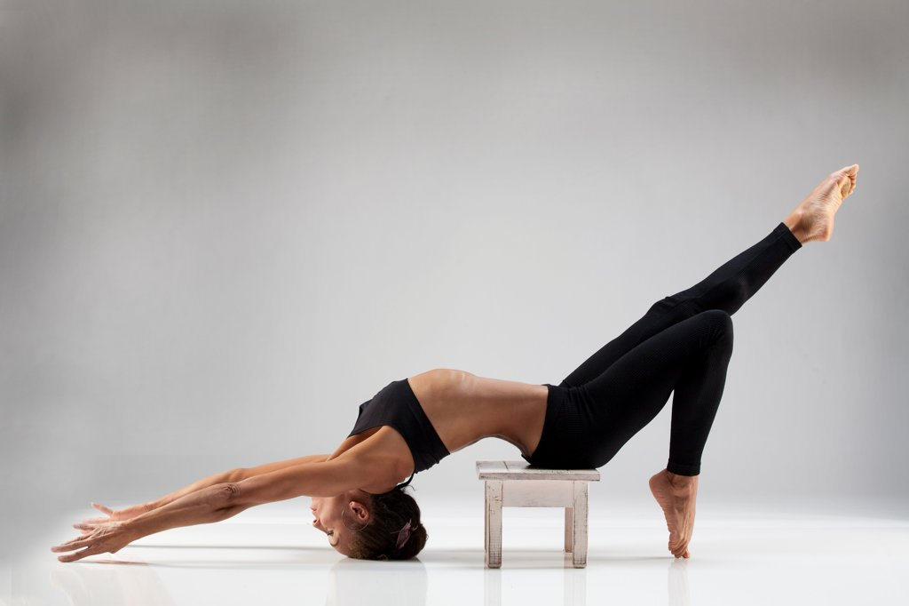 Stock Photo: 1087-3996 Studio shot of female gymnast on stool