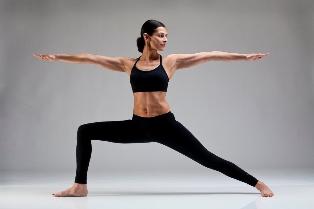 Stock Photo: 1087-4084 Studio shot of exercising woman