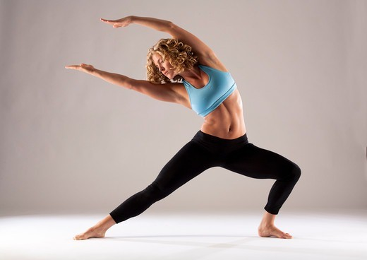 Stock Photo: 1087-4106 Studio shot of woman exercising