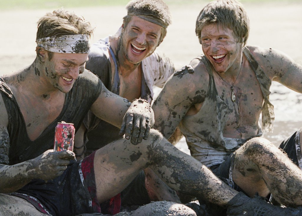 Stock Photo: 1087-532 Close-up of three young men covered with mud smiling