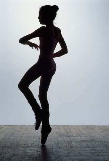 Silhouette of a ballerina dancing : Stock Photo