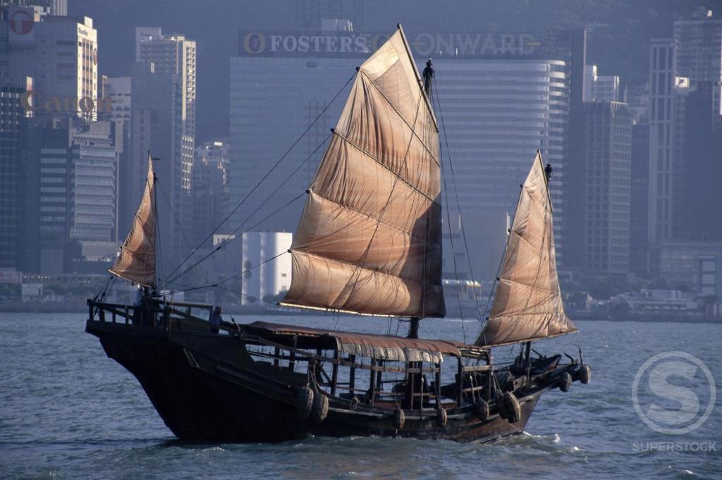 Chinese Junk sailing in the sea, Hong Kong Harbor, Hong Kong, China : Stock Photo