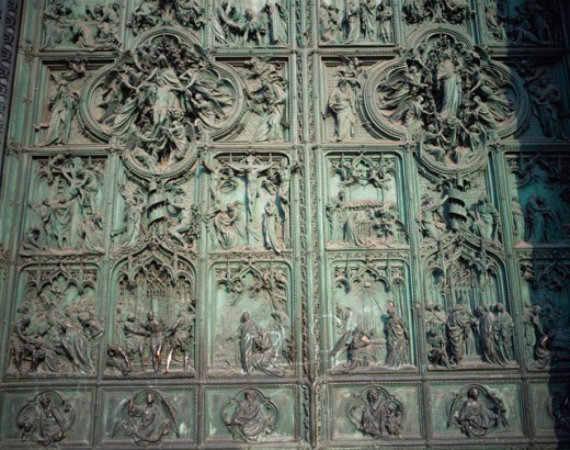Stock Photo: 1096-1487A Close-up of sculptures carved on a door, Bronze Door, Duomo di Milano, Milan, Italy