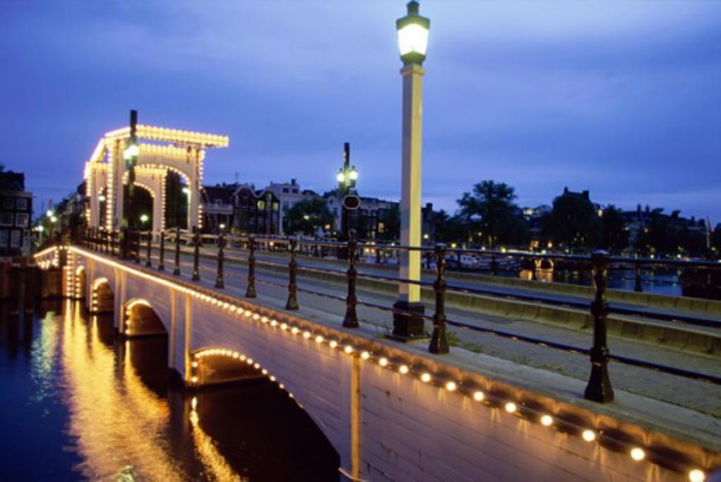 Skinny Bridge illuminated at dusk, Amsterdam, Netherlands : Stock Photo