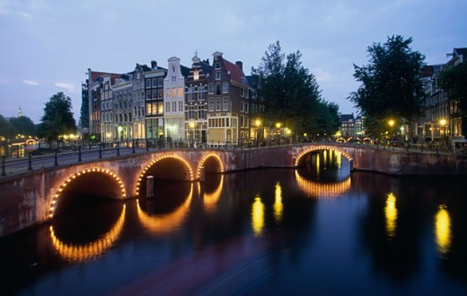 Stock Photo: 1096-1807C Arch bridge lit up at dusk, Amsterdam, Netherlands