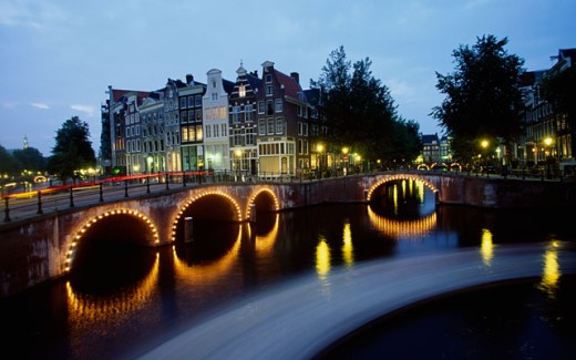 Stock Photo: 1096-1807D Arch bridge lit up at dusk, Amsterdam, Netherlands