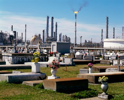 Cemetery with a factory in the background : Stock Photo