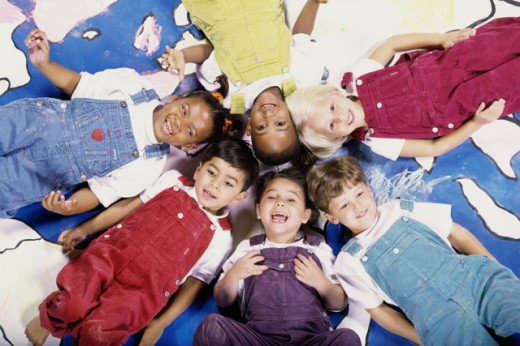 Portrait of a group of children lying down : Stock Photo