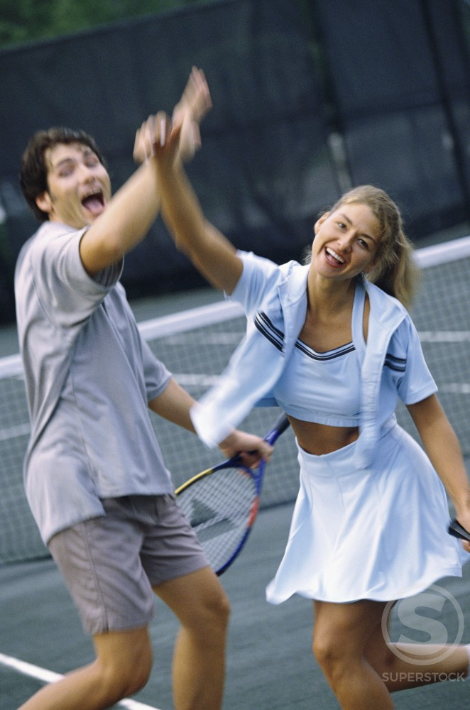 Young couple playing tennis : Stock Photo