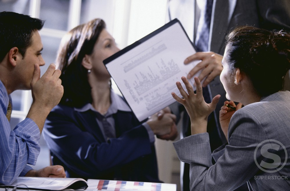 Group of business executives in an office : Stock Photo