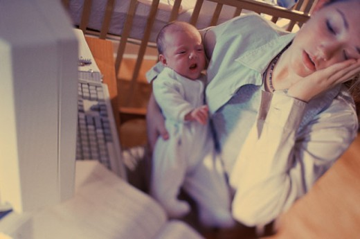 Mother holding a newborn baby : Stock Photo