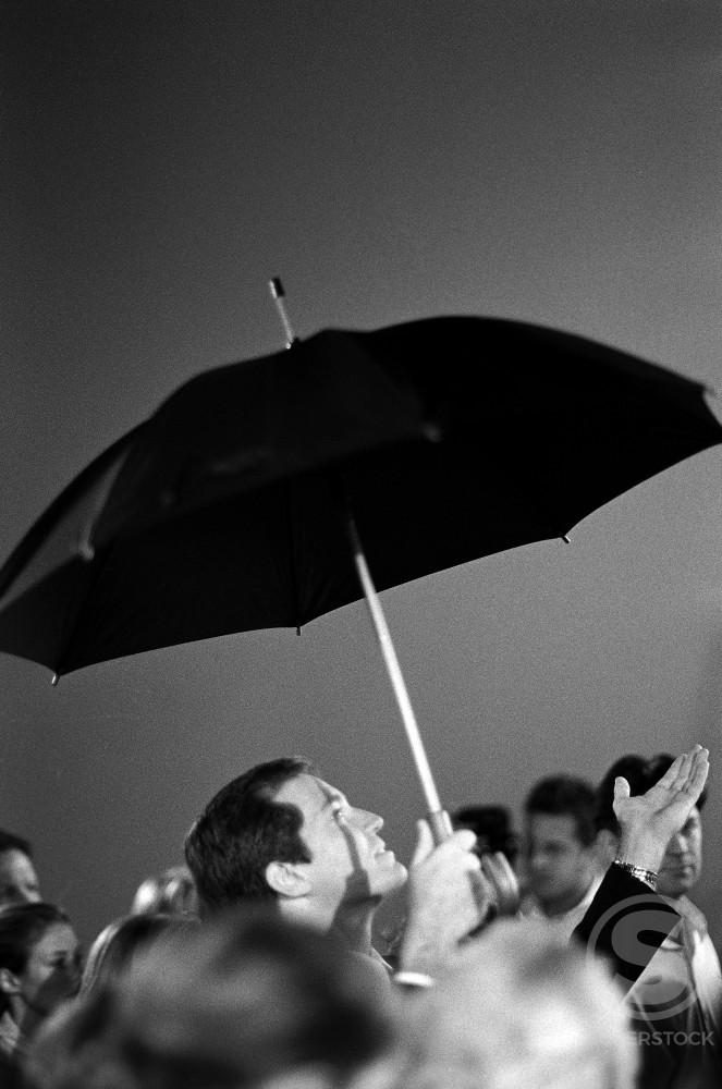 Stock Photo: 1098-2681 Businessman holding an umbrella