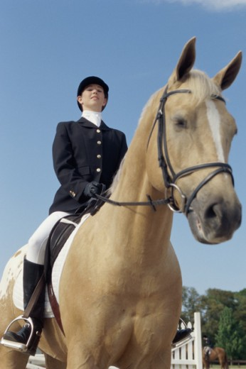 Stock Photo: 1098-4693 Low angle view of a jockey sitting on a horse