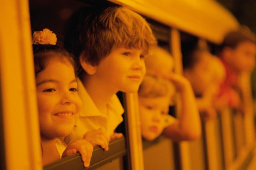 Stock Photo: 1098-491 Group of children looking through the windows of a school bus
