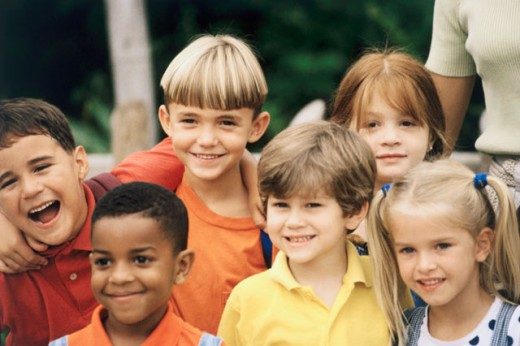 Close-up of a group of boys and girls smiling : Stock Photo