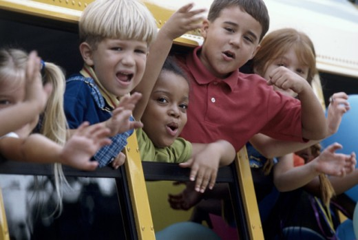 Children on a school bus during a field trip : Stock Photo