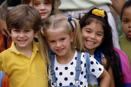 Close-up of a boy and girls smiling : Stock Photo