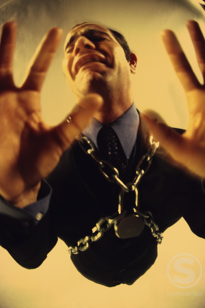 Businessman in chains : Stock Photo