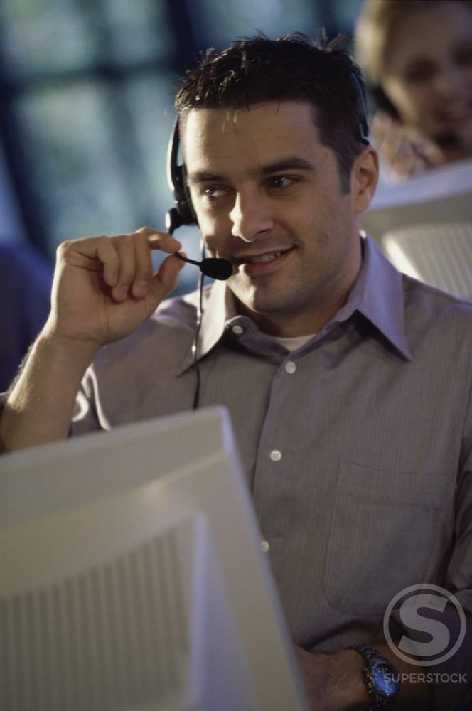 Customer service representative talking on a headset : Stock Photo