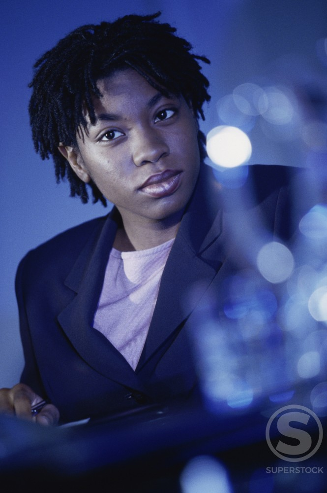 Businesswoman in an office : Stock Photo