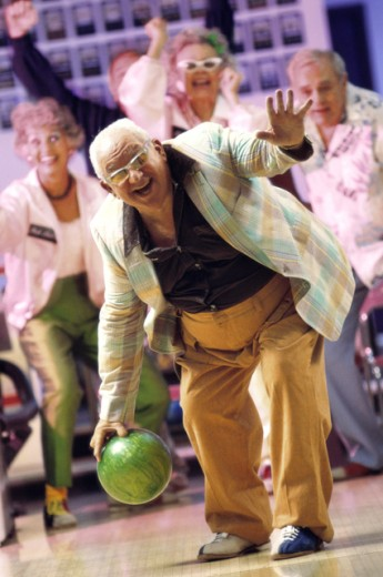 Senior man bowling : Stock Photo