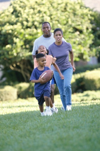 Stock Photo: 1099-1052 Parents playing football with their son and daughter