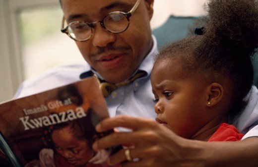 Stock Photo: 1099-155 Close up of father and daughter reading book