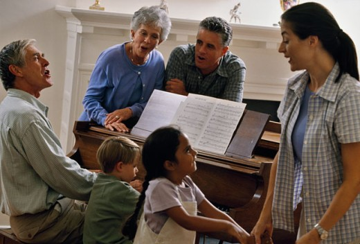 Stock Photo: 1099-2444A Family singing together near a piano