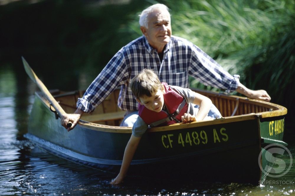 Grandfather with his grandson in a boat : Stock Photo