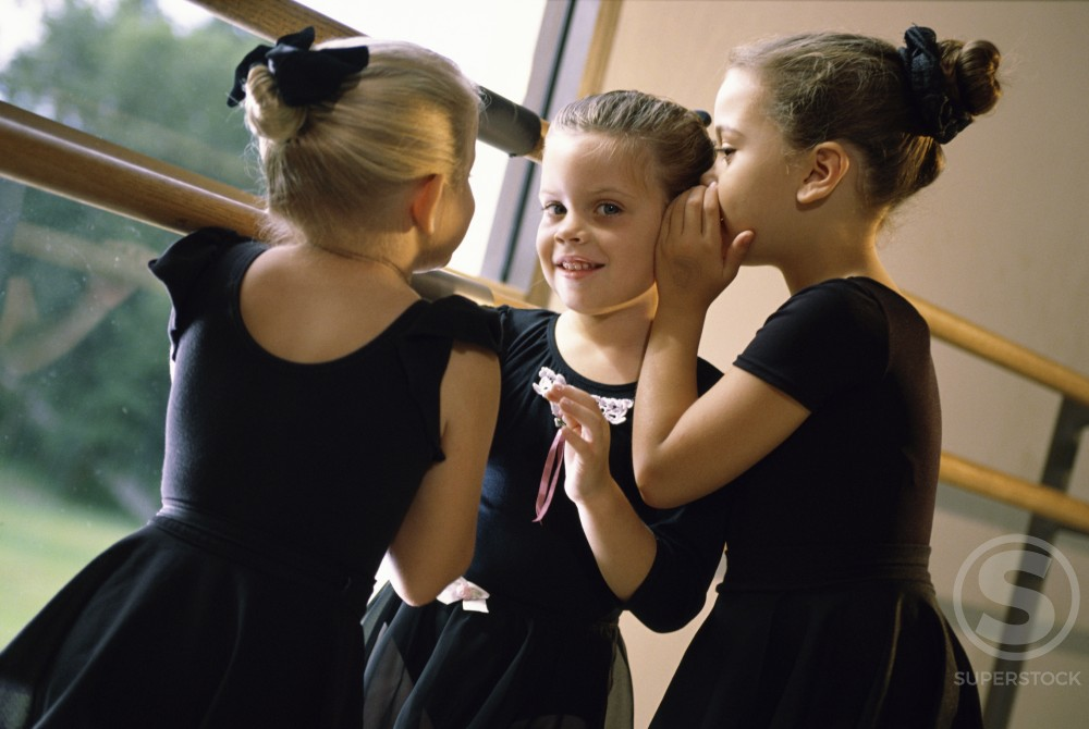 Three ballerinas whispering : Stock Photo