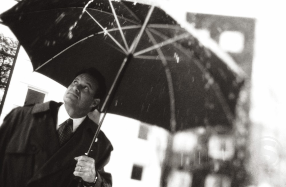 Stock Photo: 1099-3386B Businessman holding an umbrella