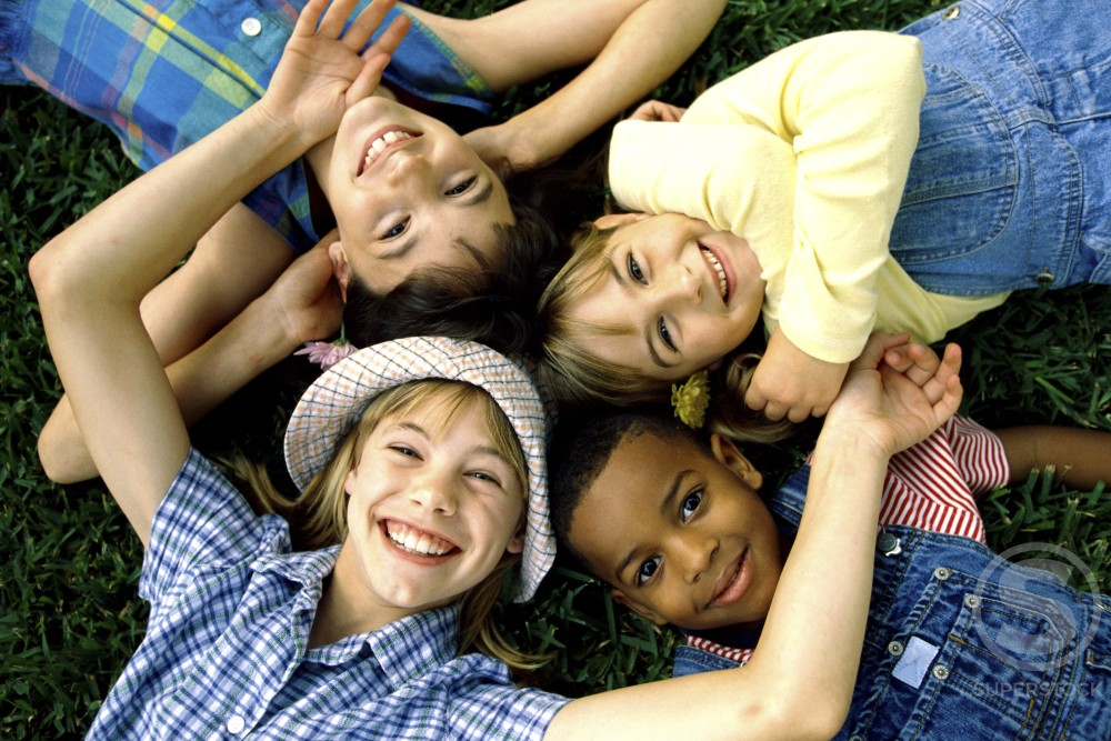 Stock Photo: 1099-420A Portrait of a group of children lying down