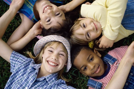 Stock Photo: 1099-420B Portrait of a group of children lying down