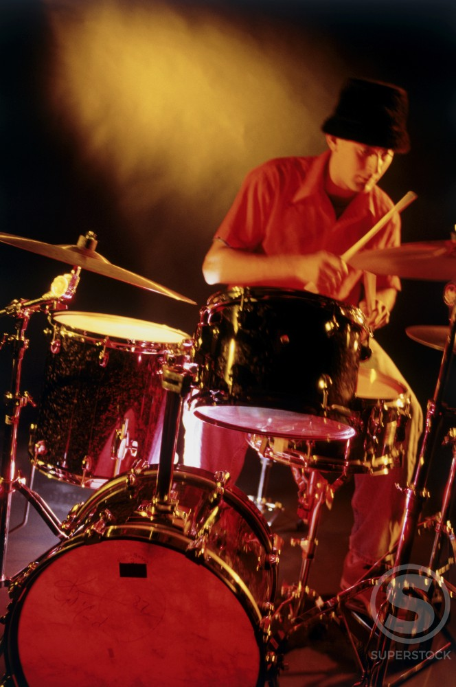 Stock Photo: 1099-5322A Male drummer playing drums