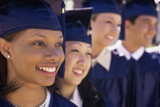 Group of young graduates standing in a row : Stock Photo