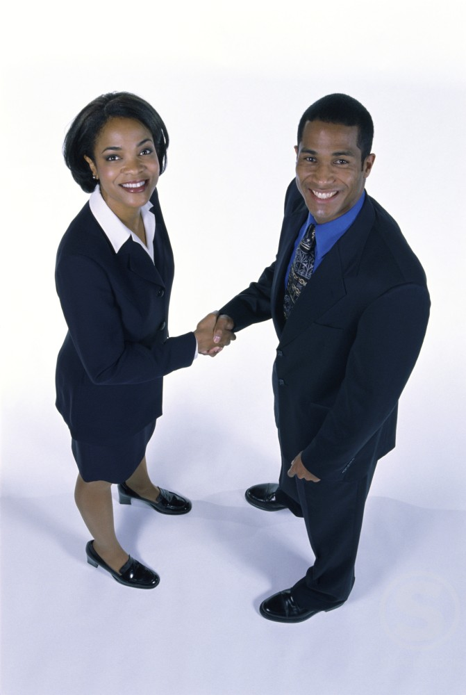 Stock Photo: 1099R-4929 Businessman shaking hands with a businesswoman
