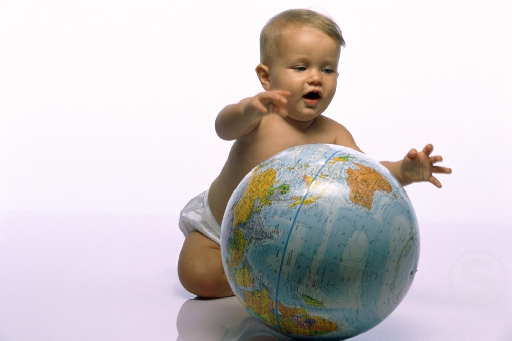 Stock Photo: 1099R-5151 Baby boy playing with a globe