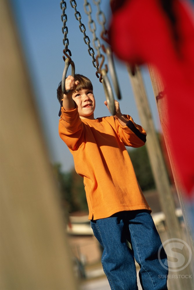 Stock Photo: 1099R-5204 Boy playing on a jungle gym