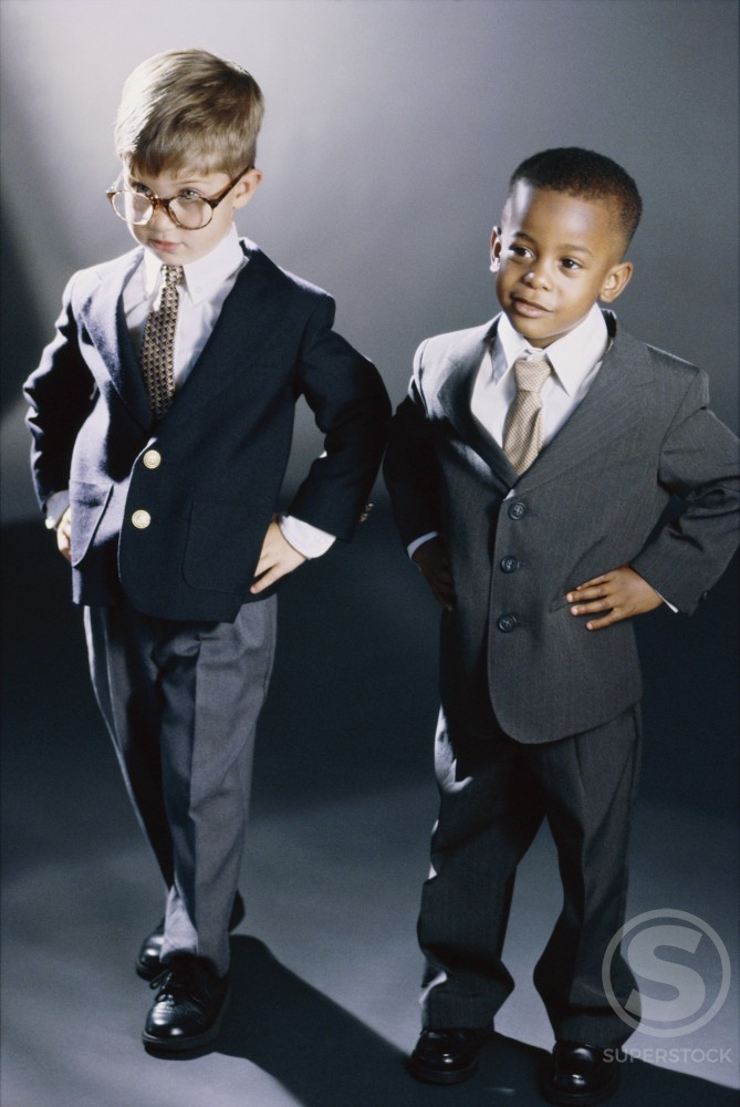 Stock Photo: 1099R-5520A Portrait of two young boys dressed as businessmen