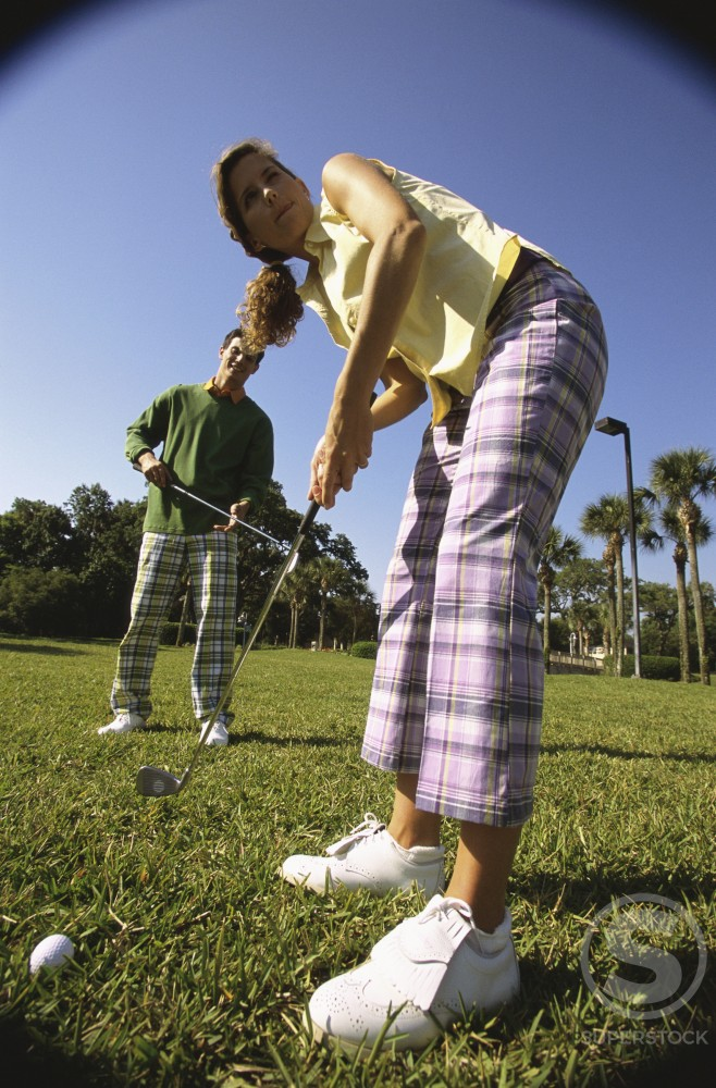 Stock Photo: 1099R-6020B Two people playing golf