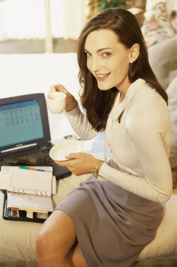 Portrait of a businesswoman working on a laptop in a hotel room : Stock Photo
