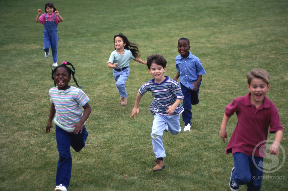 Stock Photo: 1118-108 Group of children running on a lawn
