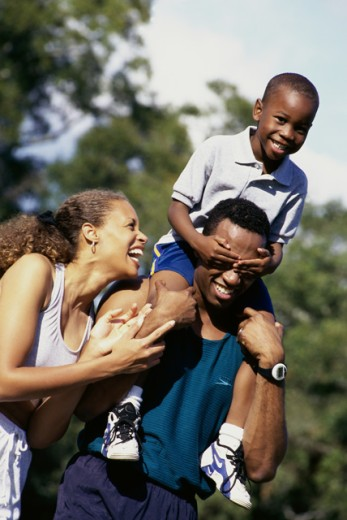 Close-up of parents with their son : Stock Photo