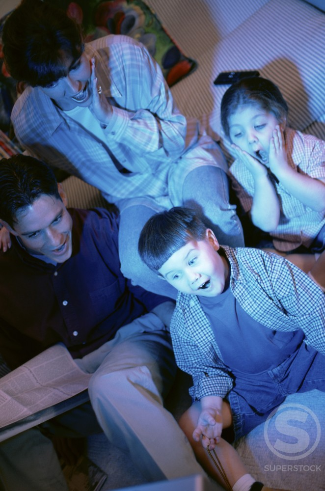 Stock Photo: 1118-118 Parents watching television with their son and daughter