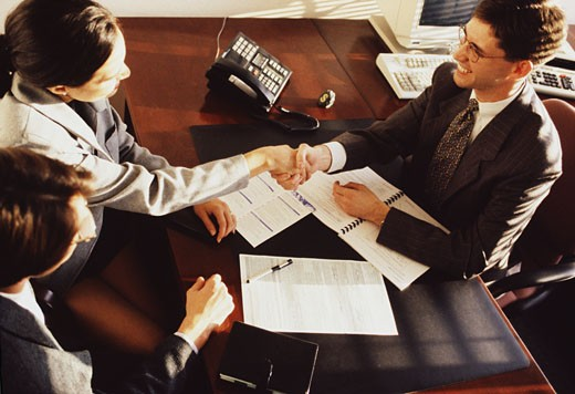 Stock Photo: 1118-121B High angle view of a businesswoman shaking hands with a businessman