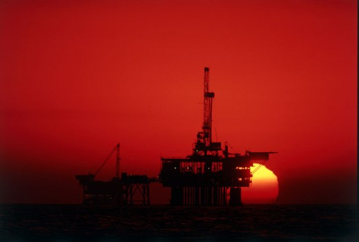 Silhouette of an oil refinery at dusk : Stock Photo
