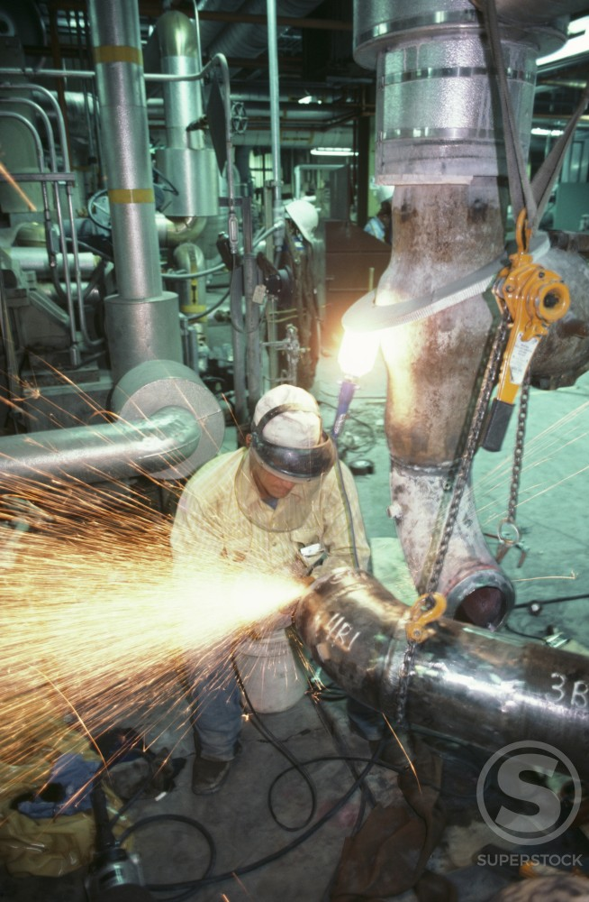 Stock Photo: 112-2338 Welder working at a construction site