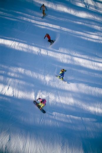 Tourists snowboarding, Purgatory, Colorado, USA : Stock Photo